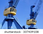 large blue and yellow cranes in ... | Shutterstock . vector #337439108