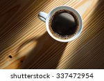 top view of a cup of coffee in... | Shutterstock . vector #337472954