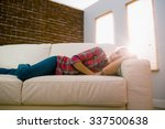 pretty blonde napping on couch... | Shutterstock . vector #337500638