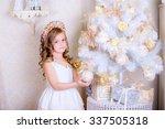 child decorate white christmas... | Shutterstock . vector #337505318