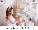 kid decorate white christmas... | Shutterstock . vector #337505348