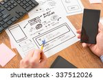 designer working at new mobile... | Shutterstock . vector #337512026