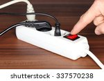 white plug socket on a wooden... | Shutterstock . vector #337570238