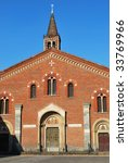 View of St. Eustorgio church against blue sky, Milan, Italy - stock photo