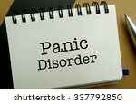 Panic disorder memo written on a notebook with pen - stock photo