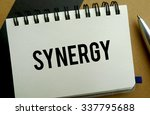 Synergy memo written on a notebook with pen - stock photo