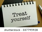 Treat yourself memo written on a notebook with pen - stock photo
