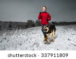 Stock photo young lady running in snowy winter field with the dog 337911809