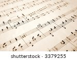 Close up of notes on an old sheet of music with shallow focus. - stock photo