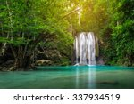 Waterfall In Deep Forest At...