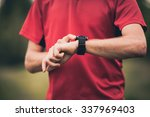 runner using heart rate monitor ... | Shutterstock . vector #337969403