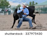 Young Cowboy Wrestling A Steer...