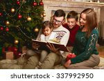 happy family of four reading... | Shutterstock . vector #337992950