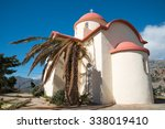 Small photo of Chapel of Sellia in the south of Crete in Greece, with a broken palm tree
