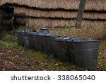 buckets in village | Shutterstock . vector #338065040