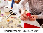 senior women sews by hand and... | Shutterstock . vector #338075909
