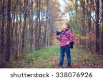 cute little boy with a camera... | Shutterstock . vector #338076926