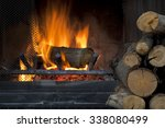Fire In Fireplace With A Pile...