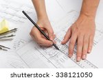 architect working on blueprint. ... | Shutterstock . vector #338121050