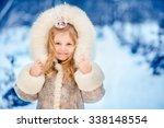 cute girl in crown standing in... | Shutterstock . vector #338148554