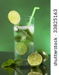 Mojito cocktail with green background - stock photo