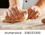 Hands Kneading Dough For Pizza...