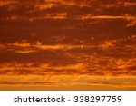 bright orange clouds at sunrise. | Shutterstock . vector #338297759