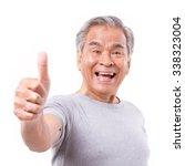 Smiling Senior Old Man Showing...