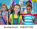happy kids enjoying a birthday... | Shutterstock . vector #338347184