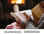 Woman Resting With Book Near...