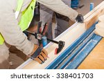 building a wall for frame house.... | Shutterstock . vector #338401703