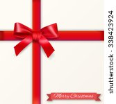 white background with red bow... | Shutterstock .eps vector #338423924