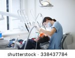 Dentist Working Without...