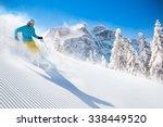 skier skiing downhill during... | Shutterstock . vector #338449520