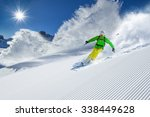 skier skiing downhill during... | Shutterstock . vector #338449628