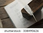 Stock photo poet writer literature idea old book book of poems and a feather 338490626