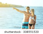 happy couple pointing at the... | Shutterstock . vector #338551520