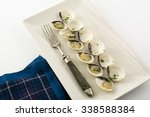 clams in white wine and parsley ... | Shutterstock . vector #338588384