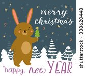 rabbit with christmas tree... | Shutterstock .eps vector #338620448