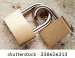 Two Linked Padlocks Symbolizing ...