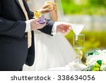 the bride and groom perform a... | Shutterstock . vector #338634056