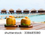 two coconut drinks on luxury... | Shutterstock . vector #338685080