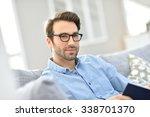 man with eyeglasses reading... | Shutterstock . vector #338701370
