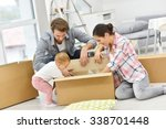 young family unpacking boxes in ... | Shutterstock . vector #338701448