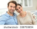 young smiling couple sitting in ... | Shutterstock . vector #338703854
