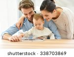 parents with baby girl playing... | Shutterstock . vector #338703869