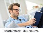Man With Eyeglasses Reading...