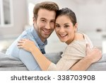 portrait of couple sitting in... | Shutterstock . vector #338703908