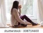 beautiful young woman sitting... | Shutterstock . vector #338714603