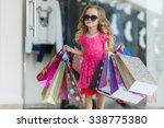 cute little girl on shopping.... | Shutterstock . vector #338775380